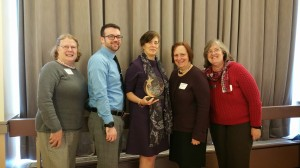 Representatives of the Wellesley Free Library receive the Stronger Together Award.